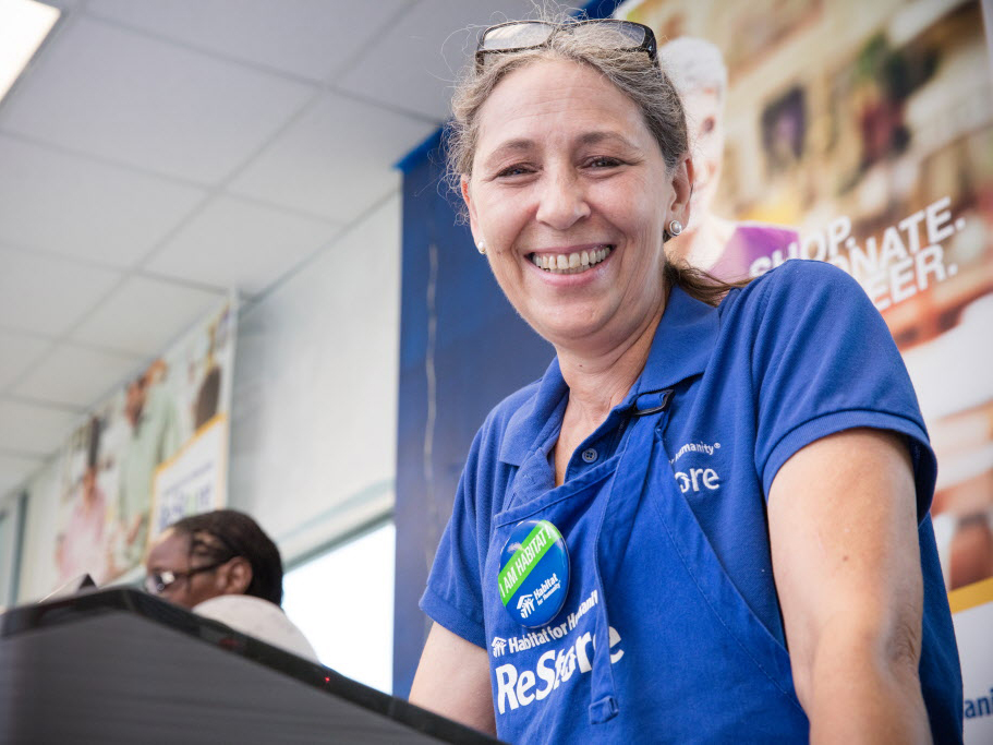 A female Restore volunteer smiling at the camera.